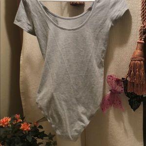 Timing on piece shirt. Snap bottom